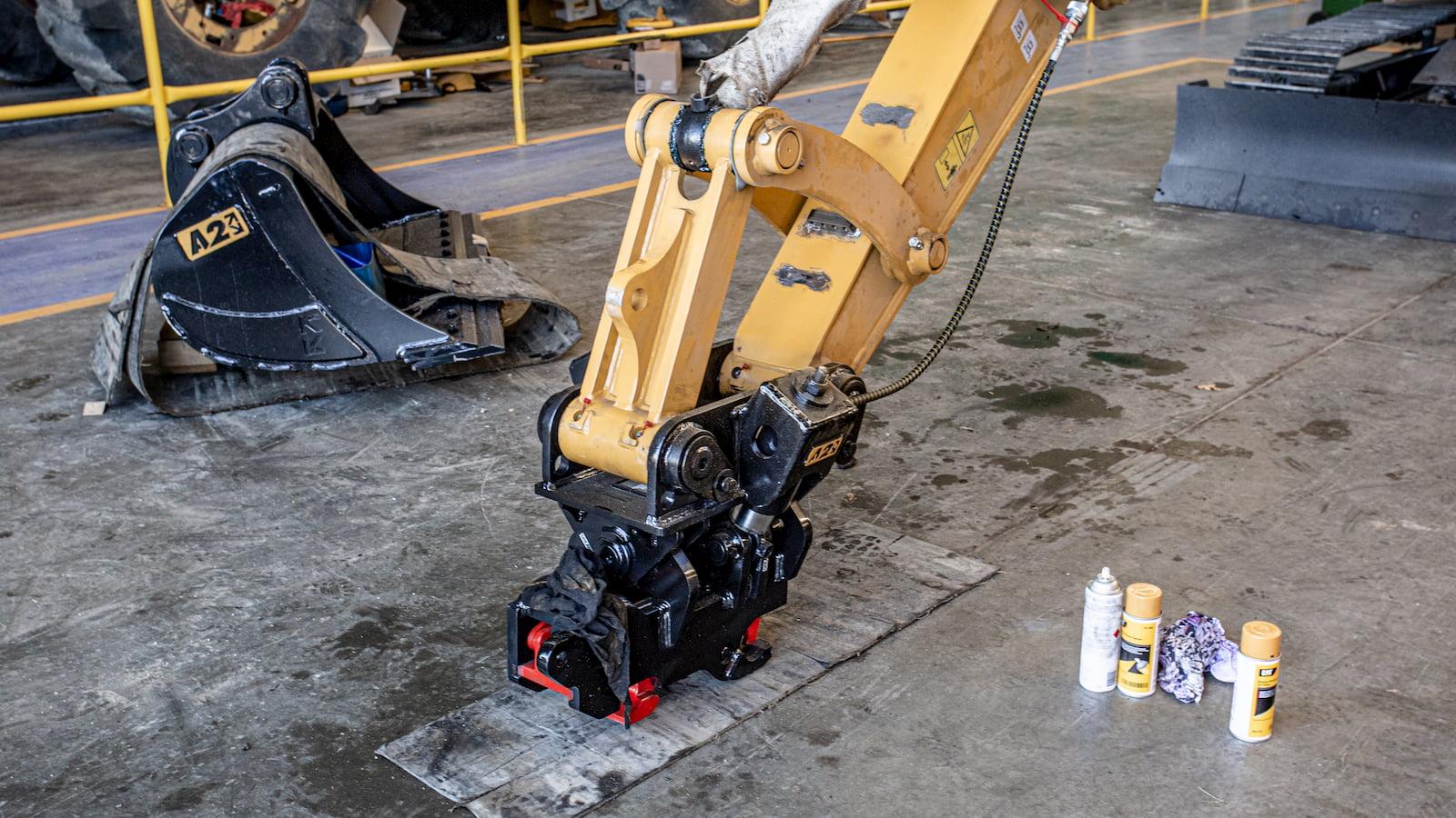 CAT310 fitting a2lock twin ram tilt coupler
