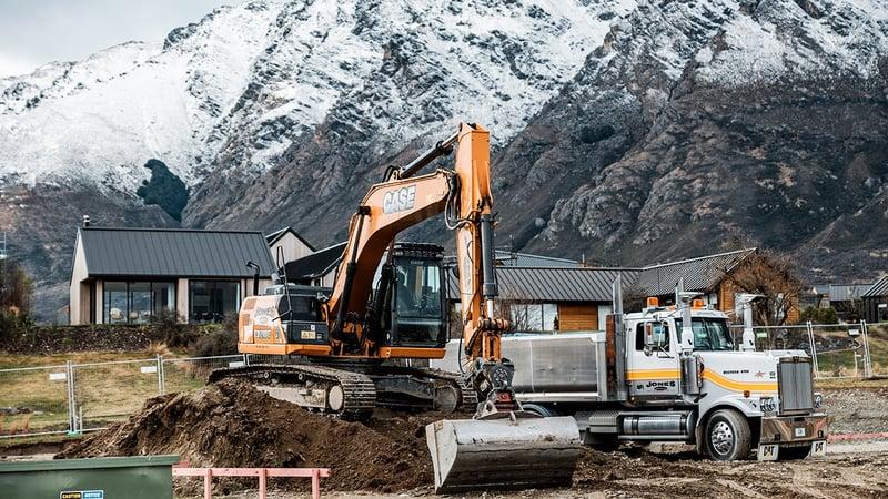 CASE CX210 beneath the Remarkable mountain ranges