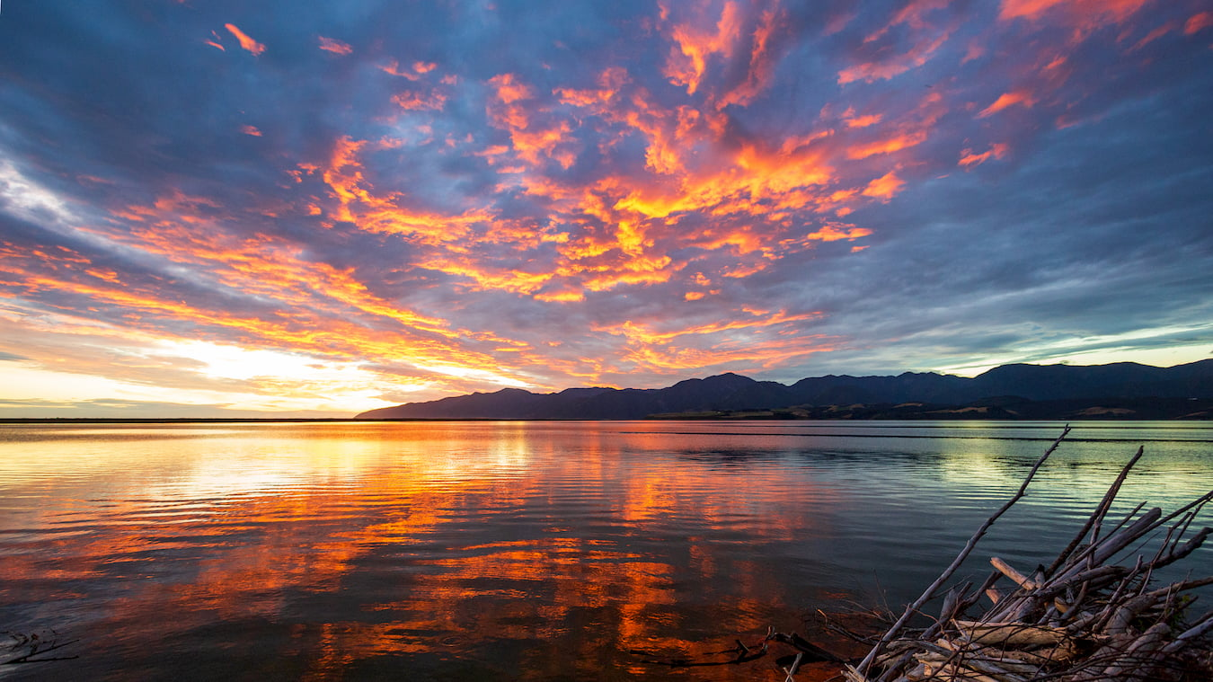Lake Wairarapa / Lake Ferry during sunset - water reflection